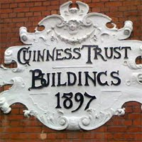 The Guinness Trust plaque on wall