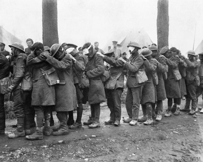 Battle of Estaires. A line of British troops blinded by tear gas at an Advanced Dressing Station near Bethune, 10 April 1918. © IWM