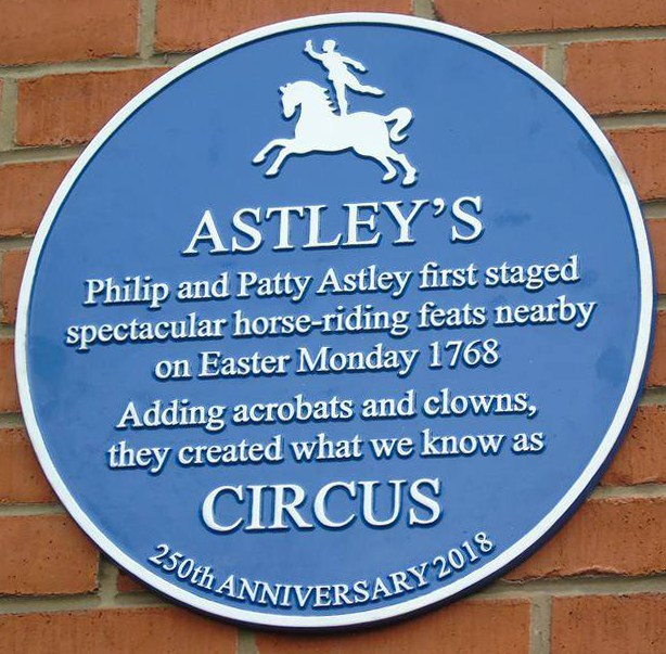 blue plaque in roupell street london se1 marking astley's circus premises