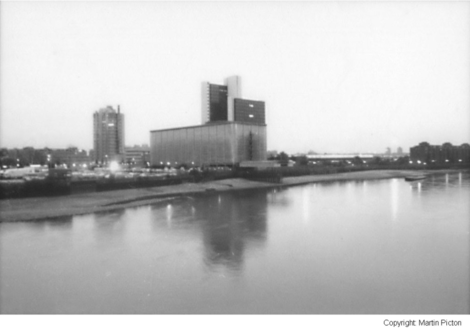 Monochrome shot of Nine Elms Cold Store from the north side of the Thames. Copyright Martin Picton