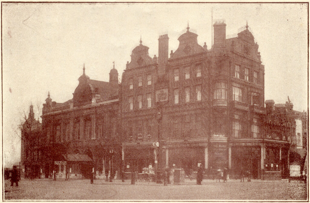 Old sepia photograph of a four-storey inn