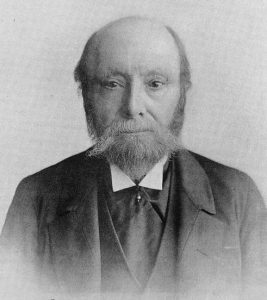 Black and white photo of middle-aged balding man with beard Henry Evans Evanion.